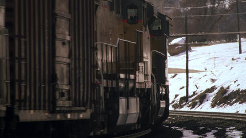 Shot of frieght train rounding a curve in wintertime Footage