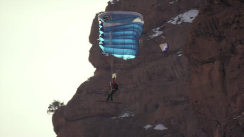 Slow-motion shot of base jumper going in for landing Footage
