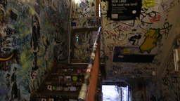 staircase with graffiti in the Monster Kabinett in Berlin Germany Footage