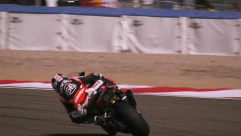 Slow motion shot of motorcycle racers on the race track Footage