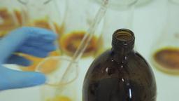 Scientist open soda-lime glass screw neck bottle in laboratory Footage