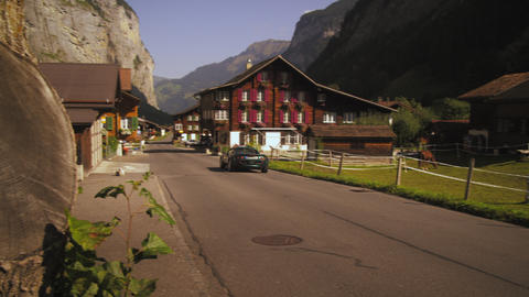 Convertible drives through small Swiss village Footage