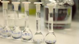 chemical laboratory flasks, slider shot Footage
