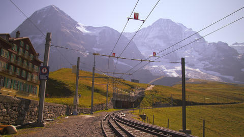 Swiss railway next to hotel in Grindelwald Footage
