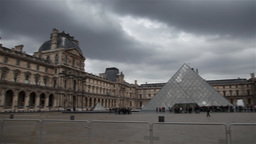 Panoramic louvre museum on a cloudy day Footage