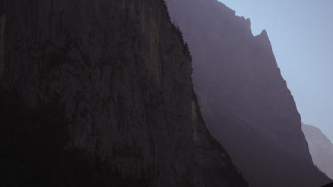 Long shot of paraglider falling off mountain Footage
