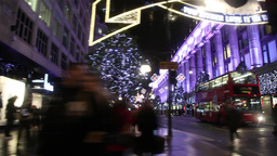 people in a London street decorated for Christmas Footage