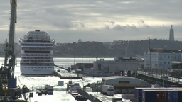 cruise ship docked in the port of Lisbon with holy Christ statue in background Footage