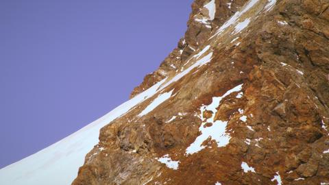 Tilting shot of Swiss mountainside Footage