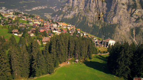 Tracking shot of a town in Switzerland taken from a descending tram Footage
