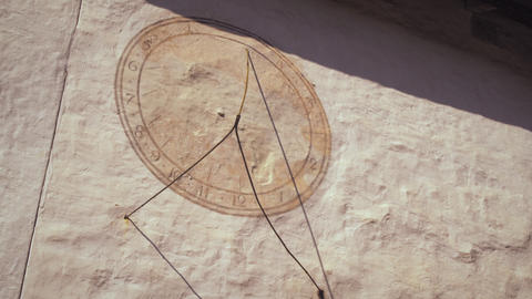 Static shot of a sundial on a wall in Switzerland Footage