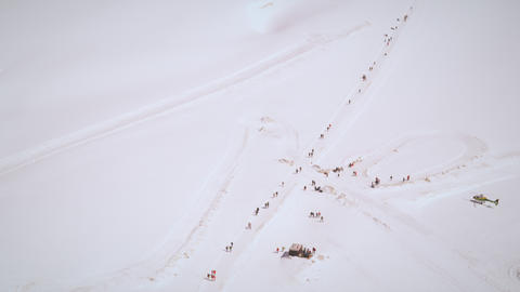 Tilting shot of several people trekking to the Swiss Alps Footage