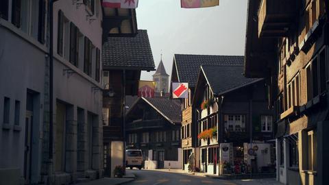 Cars traveling down Hauptstrasse road, Brienz, Switzerland Footage
