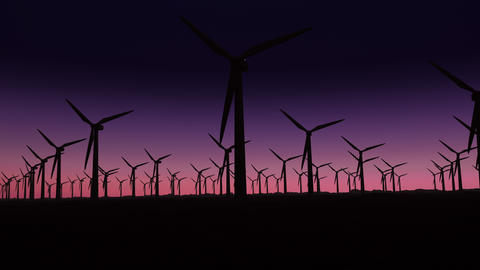 silhouette of wind turbines at sunrise with copy space GIF