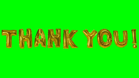 Word thank you from helium gold balloon letters floating on green screen Live Action