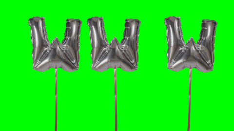 Word www web internet from helium silver balloon letters floating on green screen Live Action