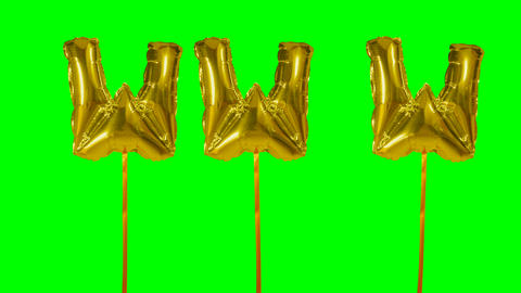 Word www web internet from helium golden balloon letters floating on green screen Live Action