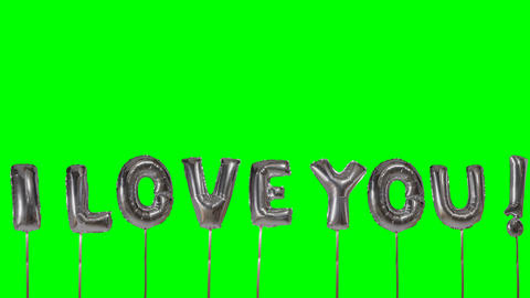 Word I love you from helium silver balloon letters floating on green screen Footage