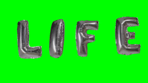 Word life from helium silver balloon letters floating on green screen Footage