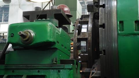 Cutting tool processing steel metal shaft on lathe machine Footage