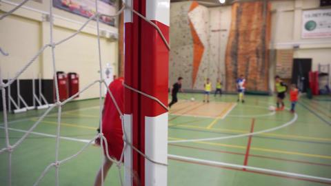 Children's indoor soccer training Stock Video Footage