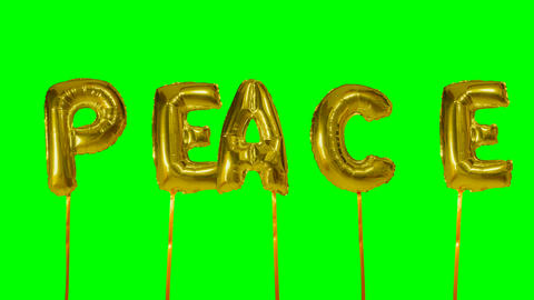 Word peace from helium golden balloon letters floating on green screen Live Action