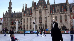 Belgium Bruges Provincial Court behind ice skating rink on market square Footage