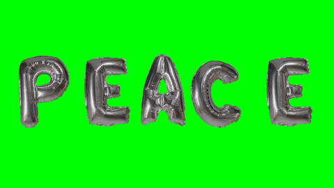 Word peace from helium silver balloon letters floating on green screen Live Action