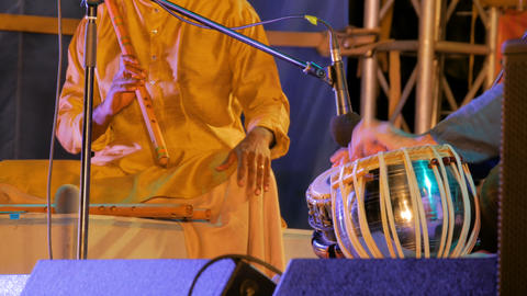Two men playing traditional Indian tabla drums and flute Live Action