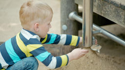 Boy is Playing with Educational Developing Equipment and Sand on the Playground Footage