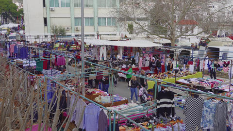 Elevated view of street vendors selling products at large bazaar flea market in Xanthi, Greece GIF