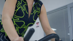 Woman working out on static bike Footage