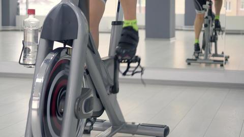 Woman feet spinning the indoor bike Footage
