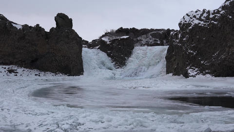 Hjalparfoss waterfall on a cloudy morning, winter in... Stock Video Footage