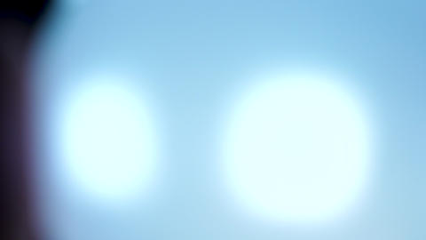 Circles of light moving through the frame one by one Stock Video Footage