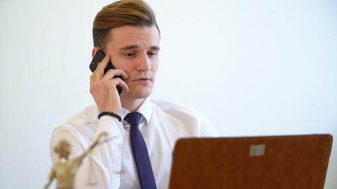 Office worker is talking on a mobile phone. Office work concept Footage