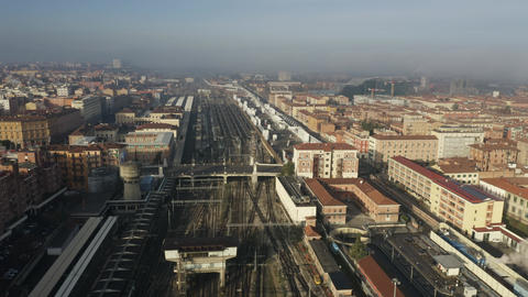 Aerial view of Bologna Centrale railroad station within cityscape, Italy Footage