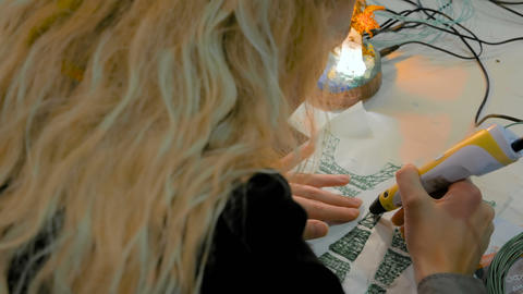 Woman using 3D printing pen Live Action