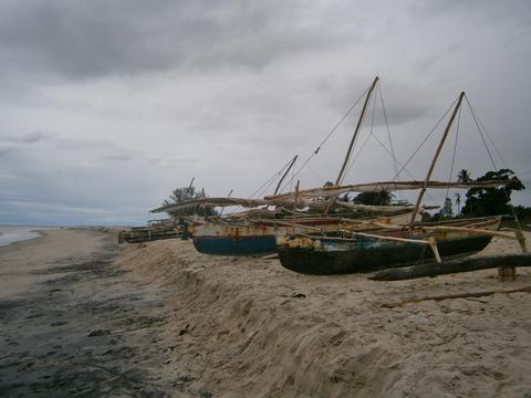 Traditional Malagasy Old Fishing Outrigger Canoe Boats on Beach, Madagascar Photo