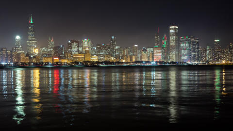 Night time lapse of Chicago, low angle just above the water Footage