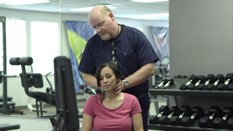 Therapist working on a woman's neck Footage