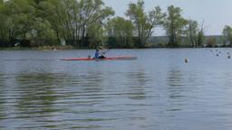 man athlete on rowing kayak on lake Footage
