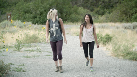 Two women hiking toward the camera Stock Video Footage