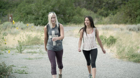 Two women hiking toward the camera Footage