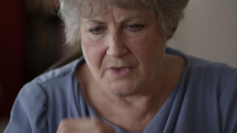 Elderly woman taking pills Live Action