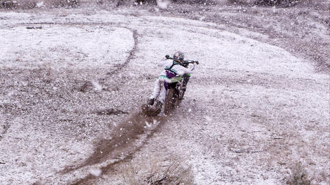 Motocross rider dragging beside motorcycle before hopping on Footage