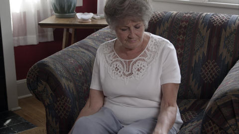 Elderly woman sitting in chair to start exercise with dumbbells Footage
