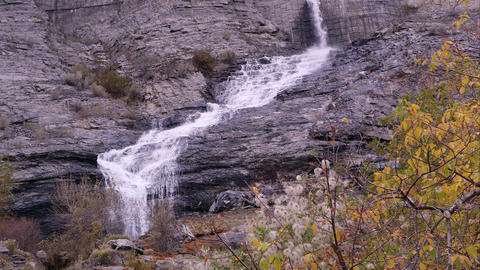 Waterfall pouring down the rocky cliff Footage