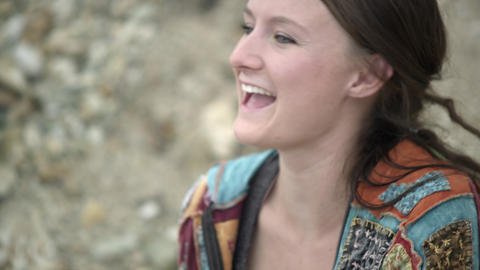 Hand held tight shot of a woman laughing outdoors Footage
