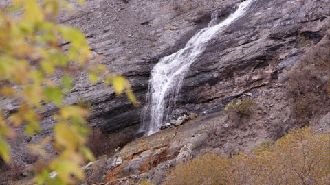 Tight shot of a waterfall cascading down the rocks Footage